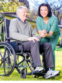 caregiver and a senior man on a wheelchair