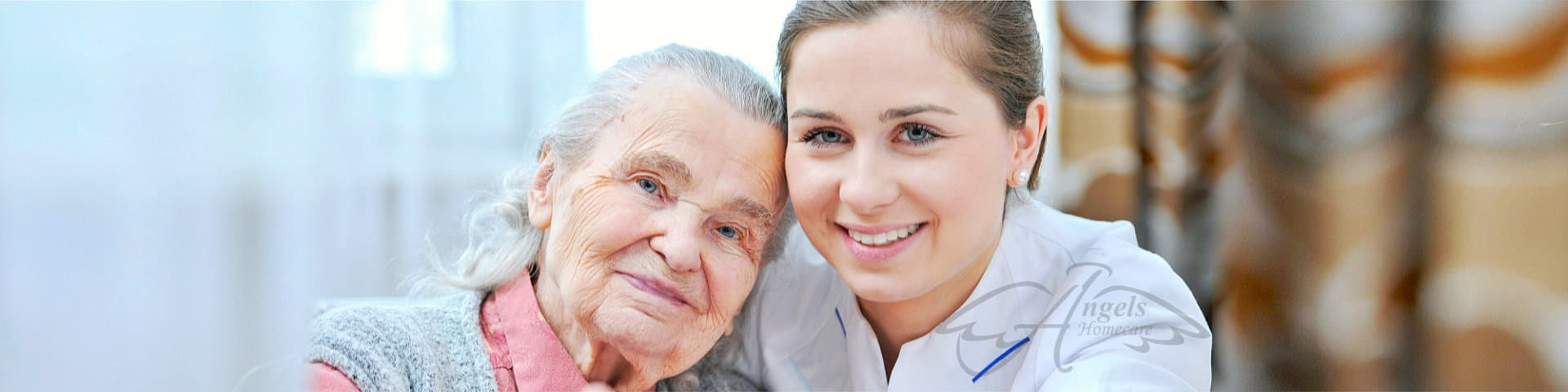 an elderly woman and a nurse are smiling